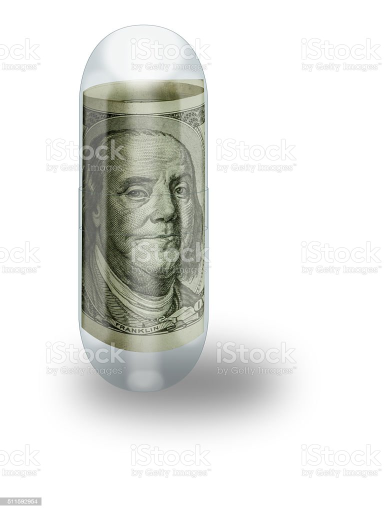 Hundred Dollar Bill in Clear Capsule Representing Health Care Cost stock photo