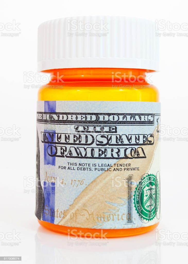 Hundred Dollar Bill Wrapped Around Orange Prescription Bottle stock photo