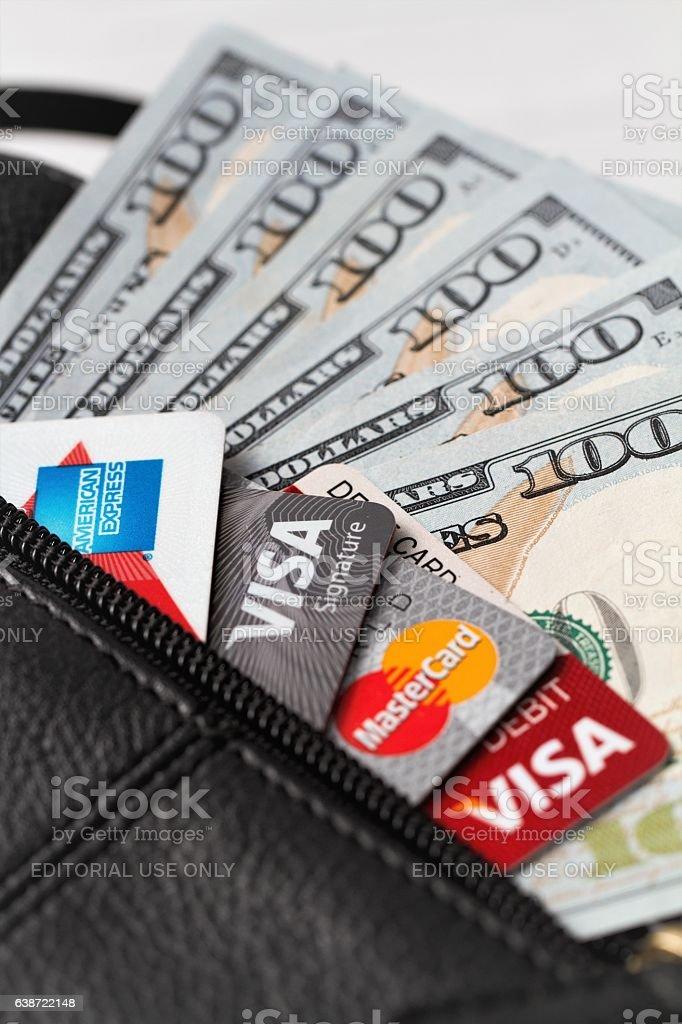 Hundred dollar bills and major credit cards stock photo