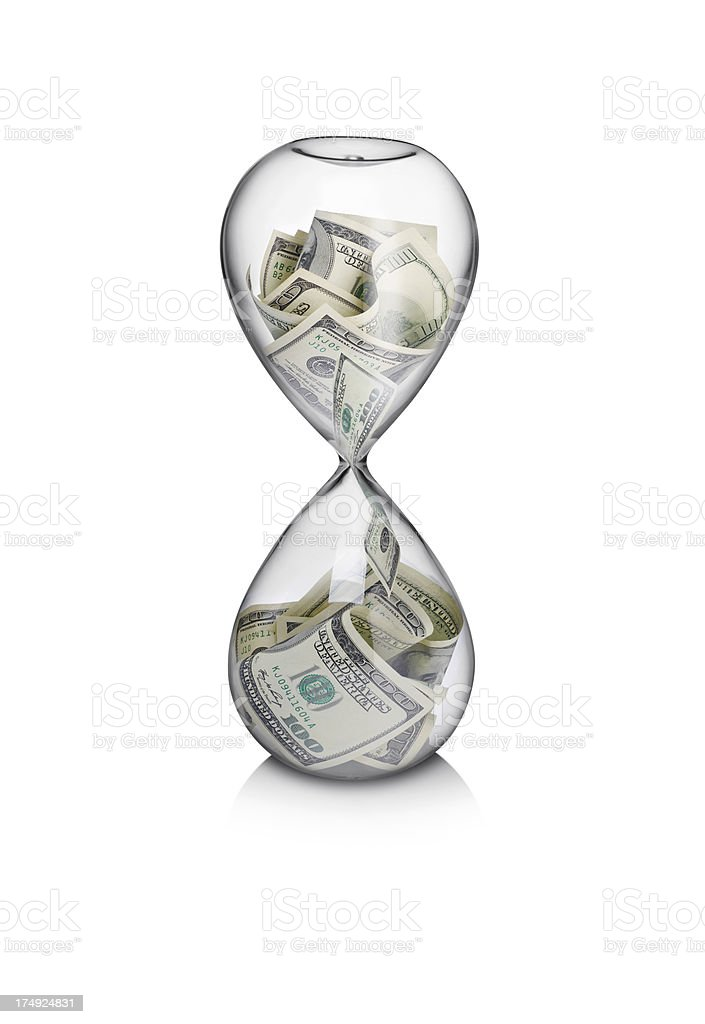 Hundred dollar bills filtering through a hourglass stock photo