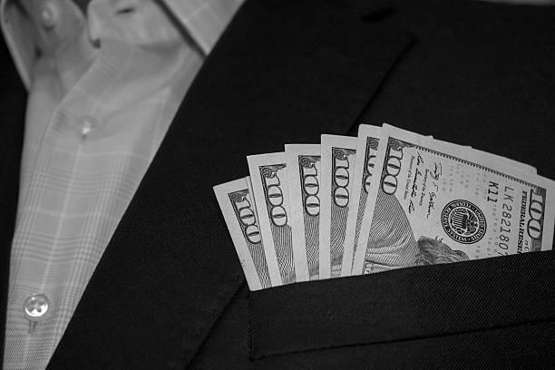 Hundred Dollar Bills Inside Suit Jacket Pocket stock photo