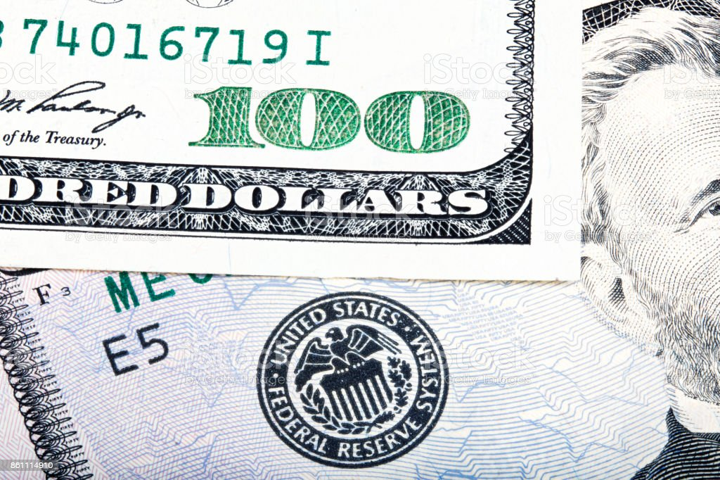 Hundred dollar near seal of Federal Reserve System. Stacked macr stock photo