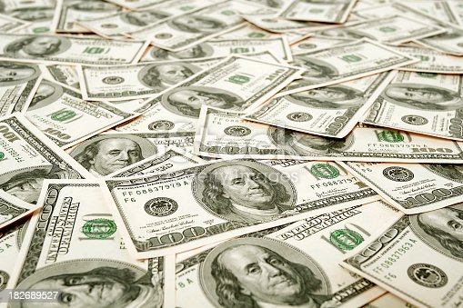 istock Hundred dollar notes covering surface 182689527