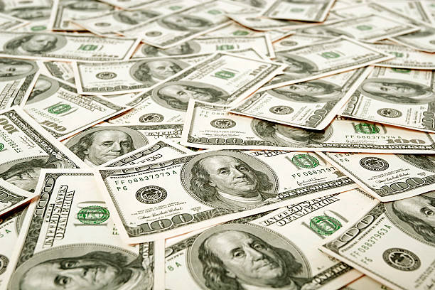 Hundred dollar notes covering surface stock photo