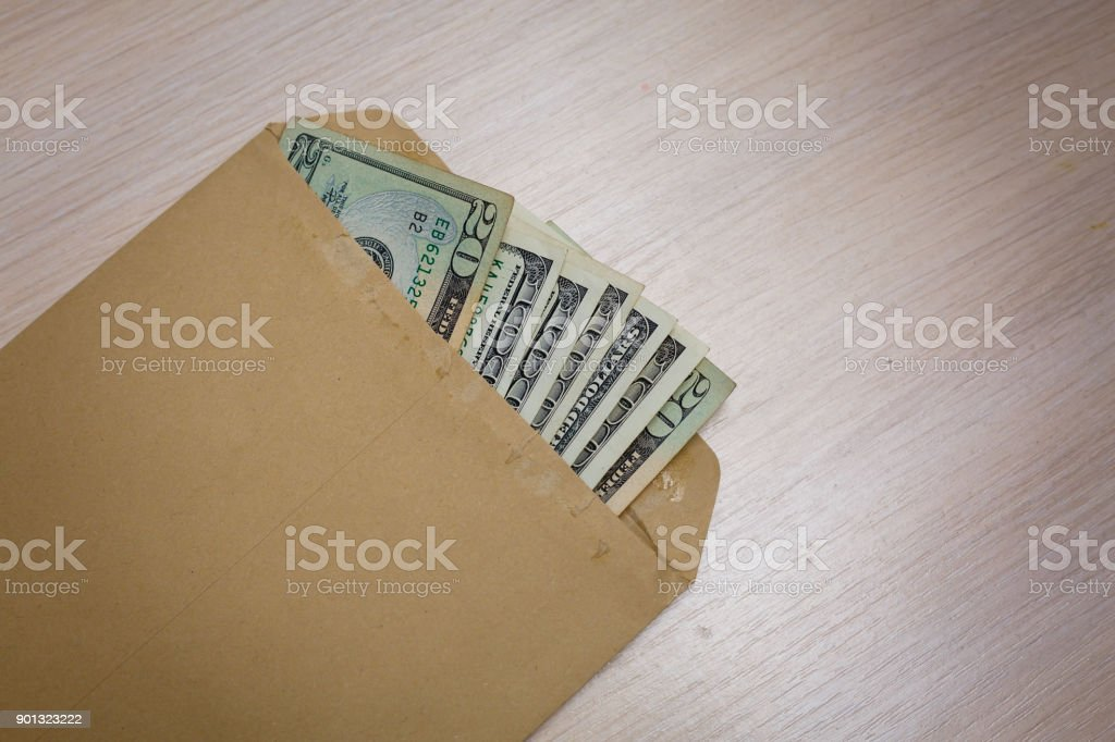 hundred dollars out of one hundred dollar bills in an envelope stock photo