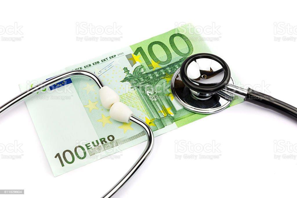 Hundred euro note with professional stethoscope on white backgro stock photo