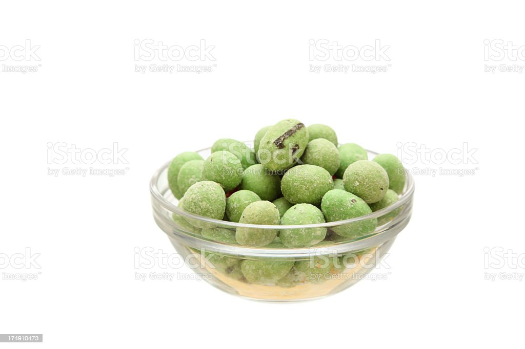 hundred gram serving of japanese wasabi peanuts in glass bowl royalty-free stock photo