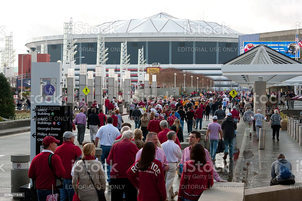 Hundreds Of Alabama Fans Walk Toward Georgia Dome stock photo