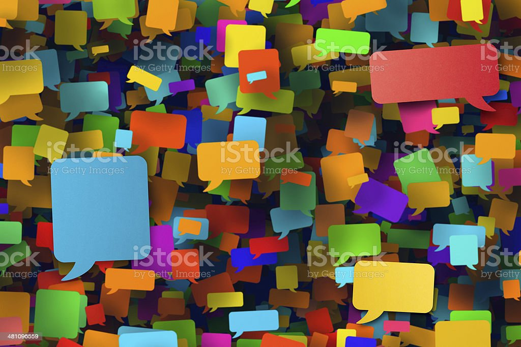 Hundreds of blank multi coloured speech bubbles stock photo