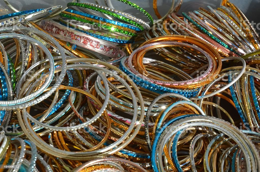 Hundreds of Colourful Bracelets for Sale Piled on a Table stock photo