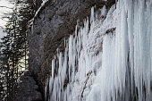 istock Hundreds of sparkling waterfalls hanging off a mountain cliff in winter 1207524643