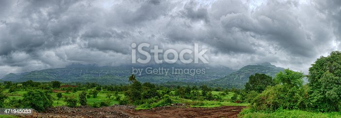 HDR Panoramic shot of beautiful hill covered in green foliage with several hundred small waterfalls during the Monsson season near Lonawala, India.