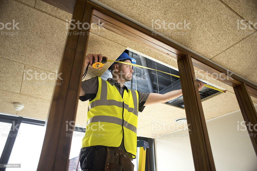 hung ceiling install stock photo