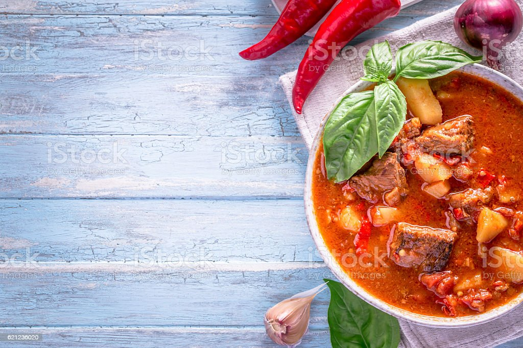 Hungarian goulash on cyan background with copy space stock photo