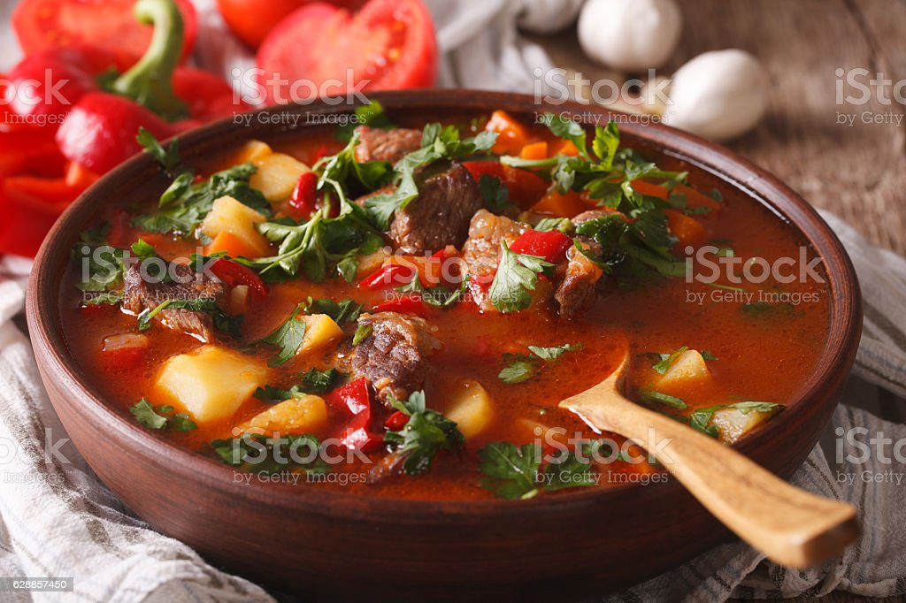 Hungarian goulash soup bograch close-up. horizontal stock photo