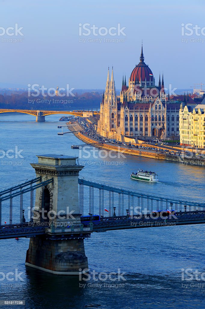 Hungarian Parliament and Chain Bridge with blue Danube river stock photo