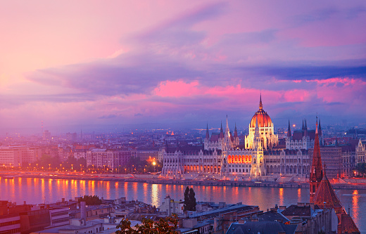 Hungarian Parliament by twilight on the bank of the Danube river