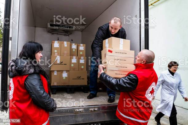 Uzhhorod, Ukraine - March 16, 2017: Employees of the Red Cross Society unload boxes of measles vaccines that entered the Transcarpathian region within the framework of humanitarian aid from Hungary.