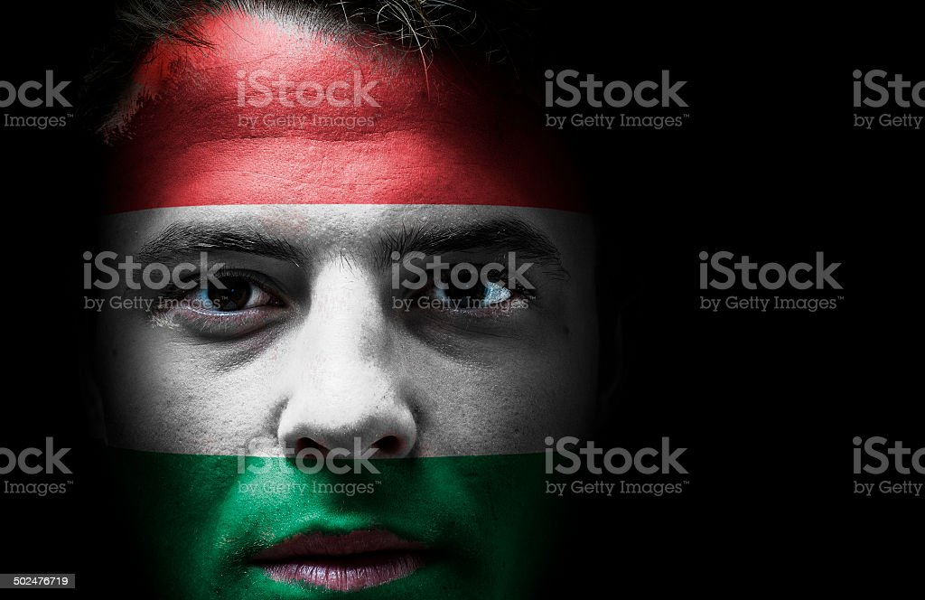 Hungary, Hungarian flag on face stock photo