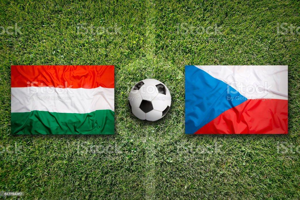 Hungary vs. Czech Republic flags on soccer field stock photo