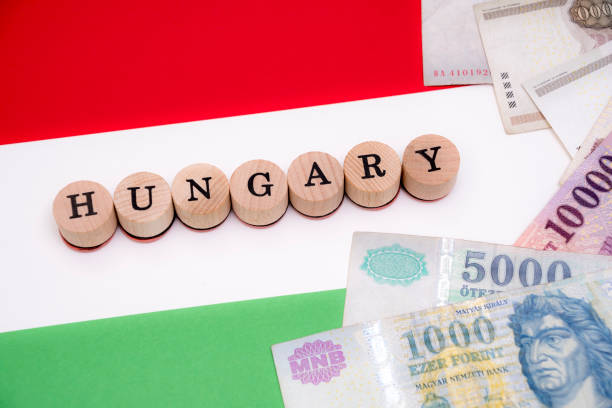Hungary with forint currency on flag stock photo
