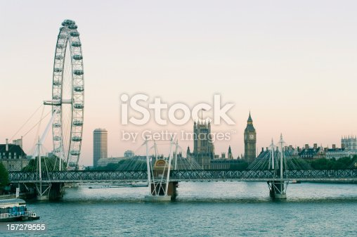 View of Hungerford Bridge at Dusk, with the Millenium Wheel (London Eye), Houses of Parliament and Big Ben.