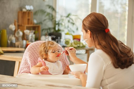 istock Hungry baby eating 850904362