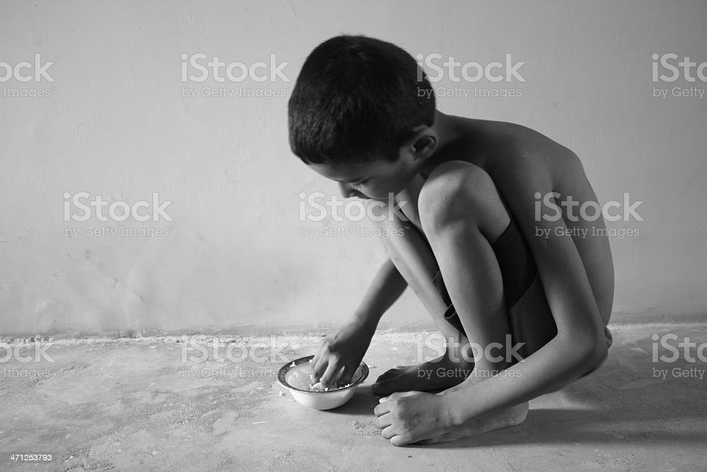 Hungry boy stock photo