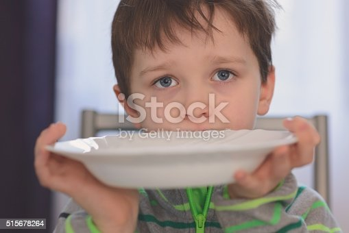 istock Hungry boy with beautiful eyes waiting for dinner 515678264