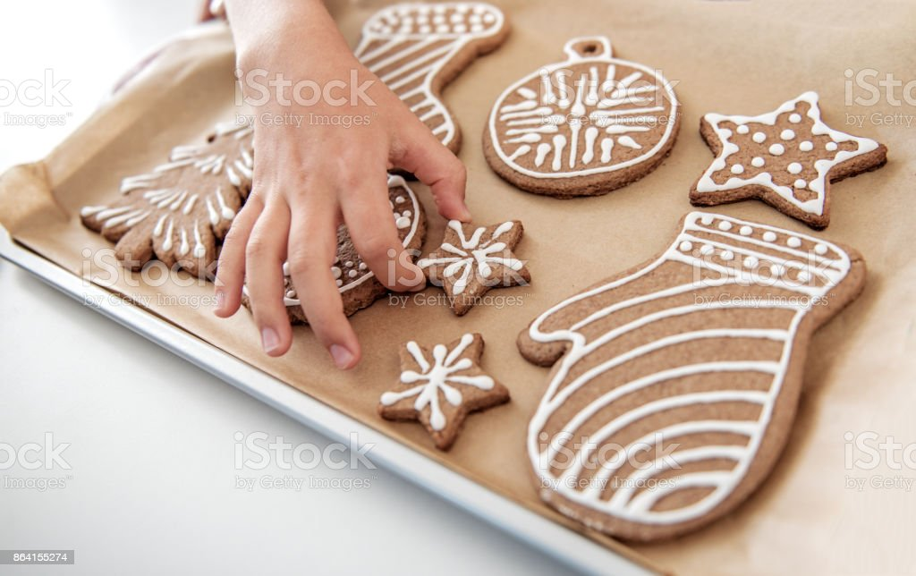 Hungry child eating baked sweet holiday pastry royalty-free stock photo