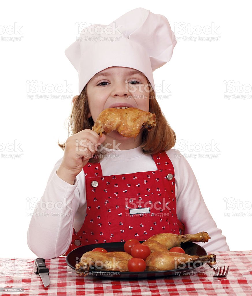 hungry little girl cook eat chicken drumstick royalty-free stock photo