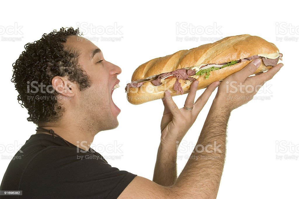 Hungry man with sandwich stock photo