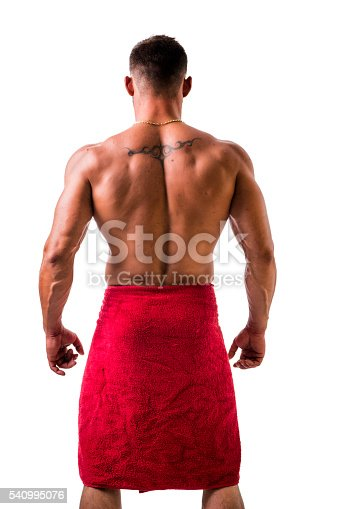 istock Hunk with towel around his neck back view 540995076