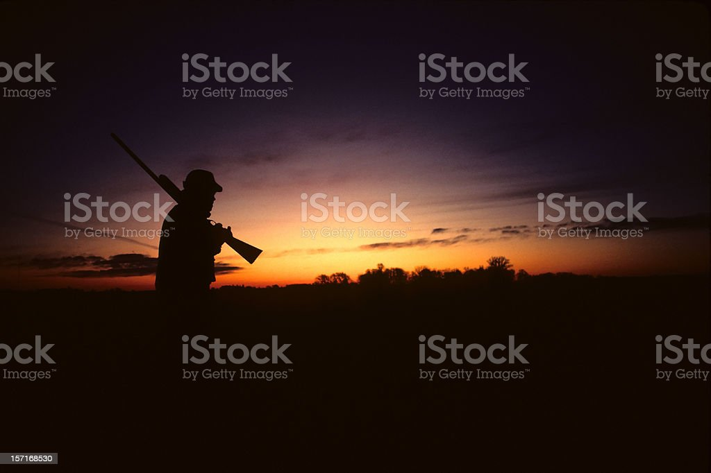 hunter afield before sunrise stock photo