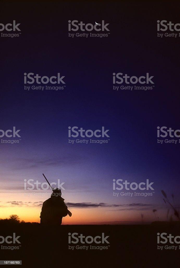 hunter afield before sunrise royalty-free stock photo