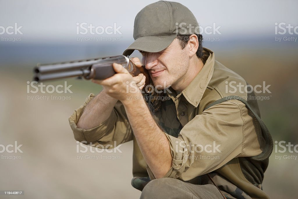Hunter aiming at hunt during a hunting party royalty-free stock photo