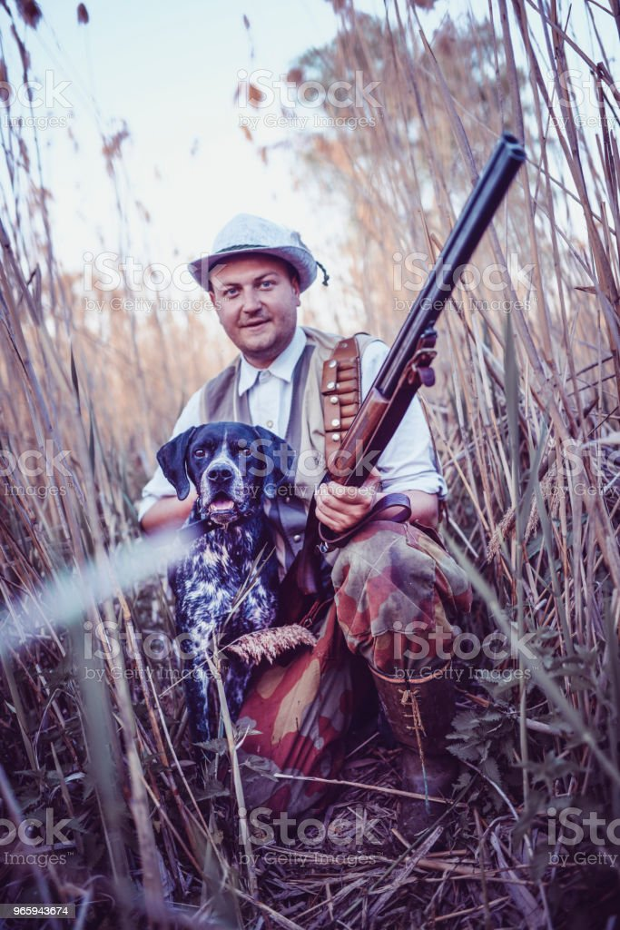 Hunter And His Hound Proud Of Their Experience - Royalty-free Adult Stock Photo