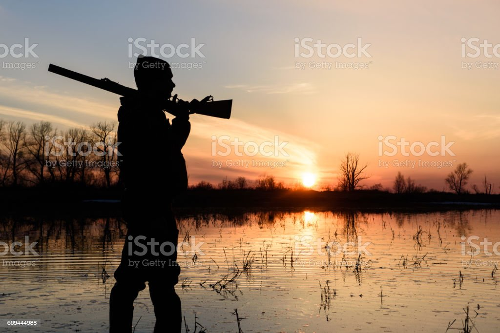 Hunter at sunset. stock photo