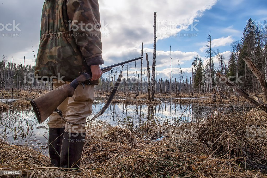 Hunter holds in his hand an old hunting rifle stock photo