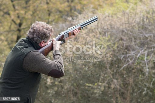 istock Hunter in forest during hunting season aiming before shoot 679716976