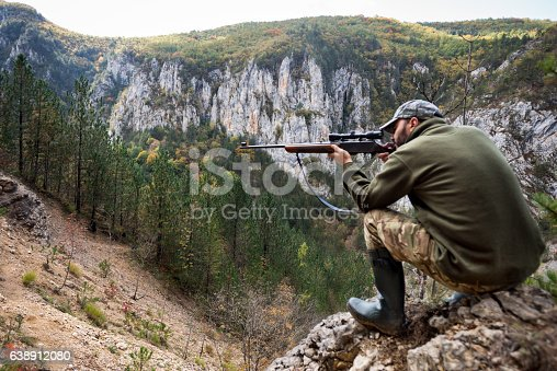 istock Hunter in the mountains 638912080