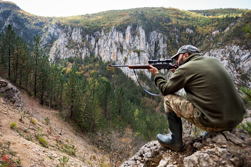 Hunter In The Mountains Stock Photo - Download Image Now