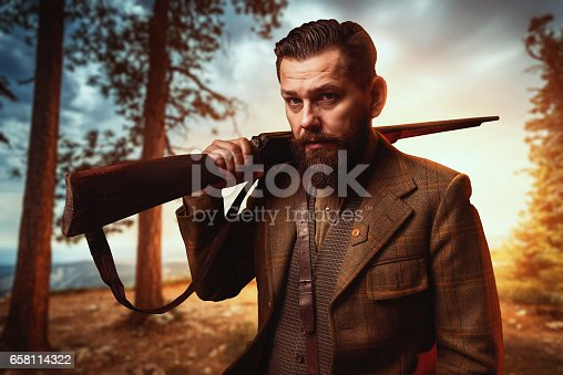 658114236 istock photo Hunter in vintage hunting clothing with old gun 658114322