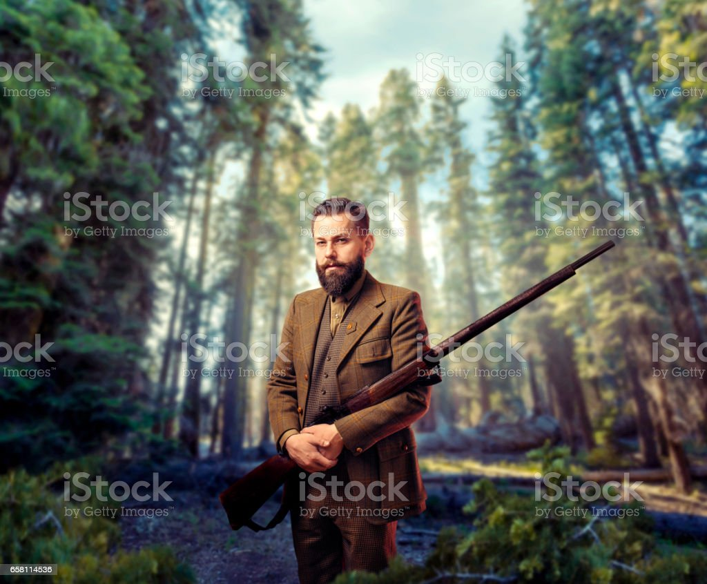 Hunter in vintage hunting clothing with old gun royalty-free stock photo