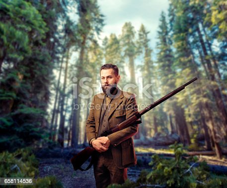 658114236 istock photo Hunter in vintage hunting clothing with old gun 658114536