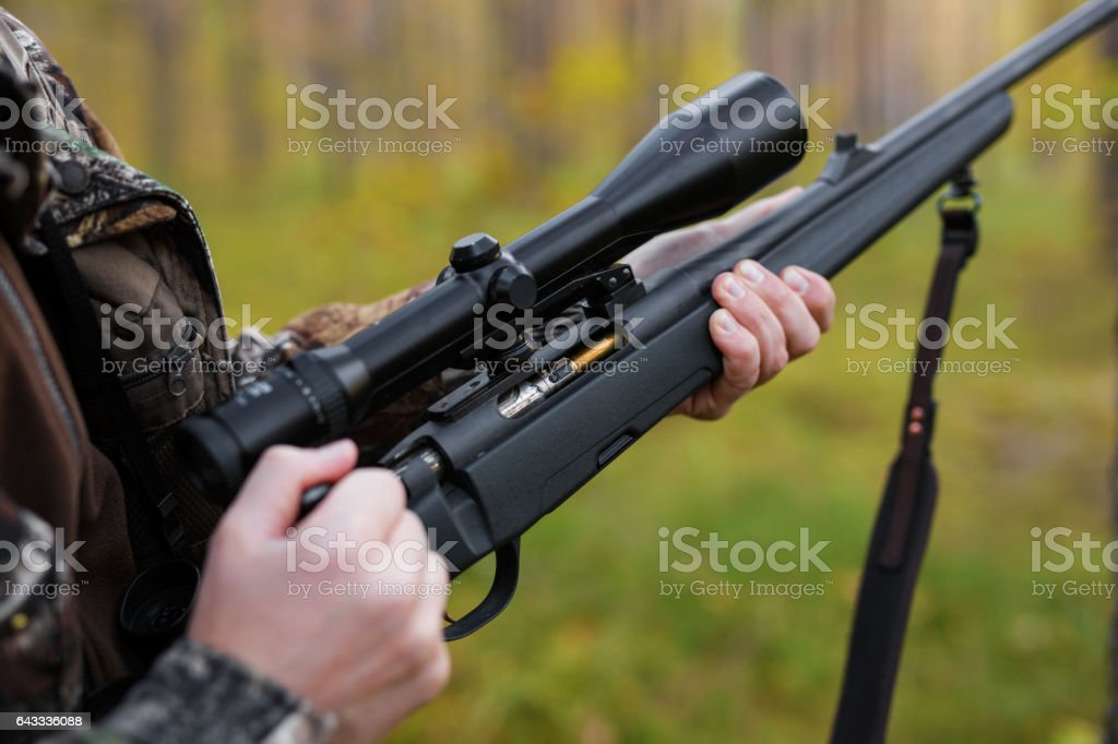 Hunter loading his gun stock photo