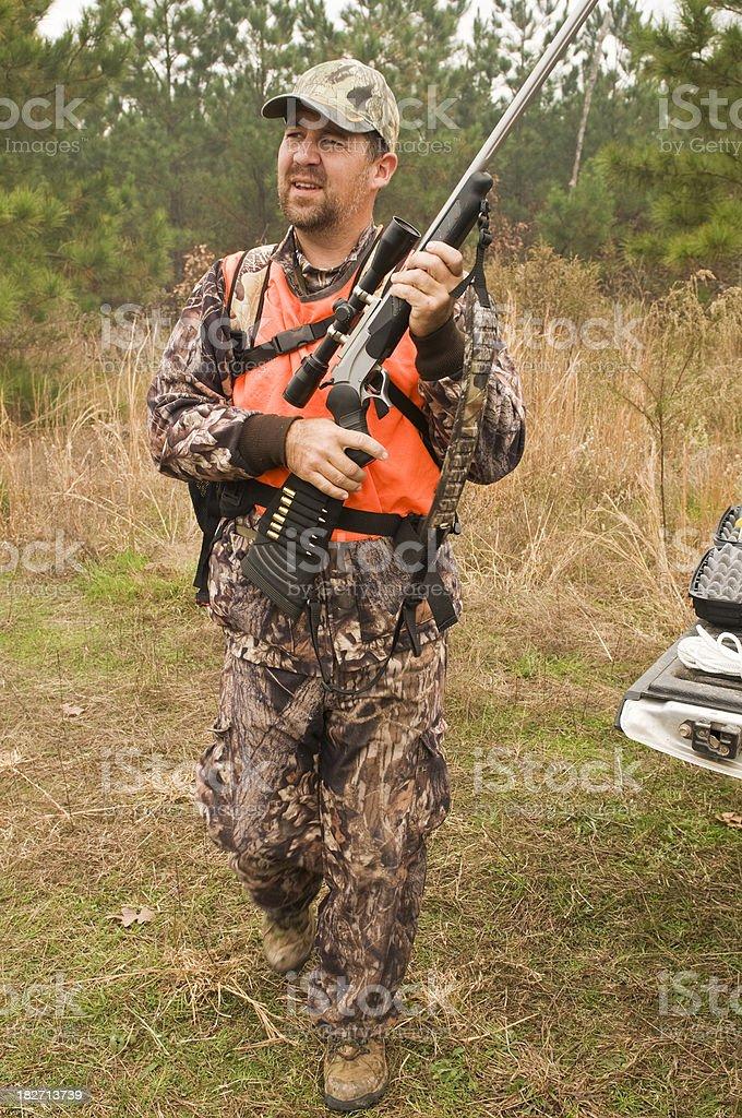 Hunter loading Rifle royalty-free stock photo