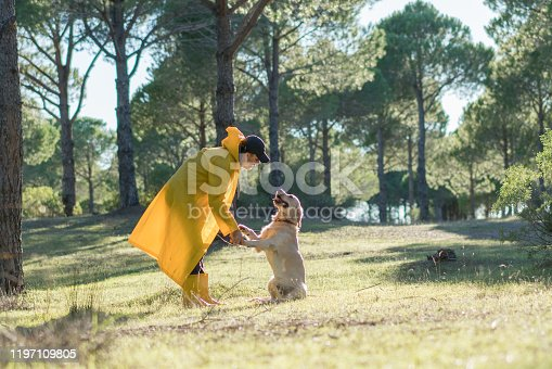 Hunter Man training with his dog  in forest