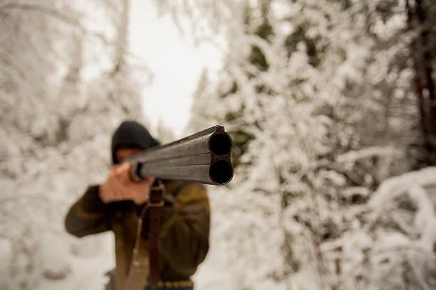 Hunter Pointing a Gun stock photo