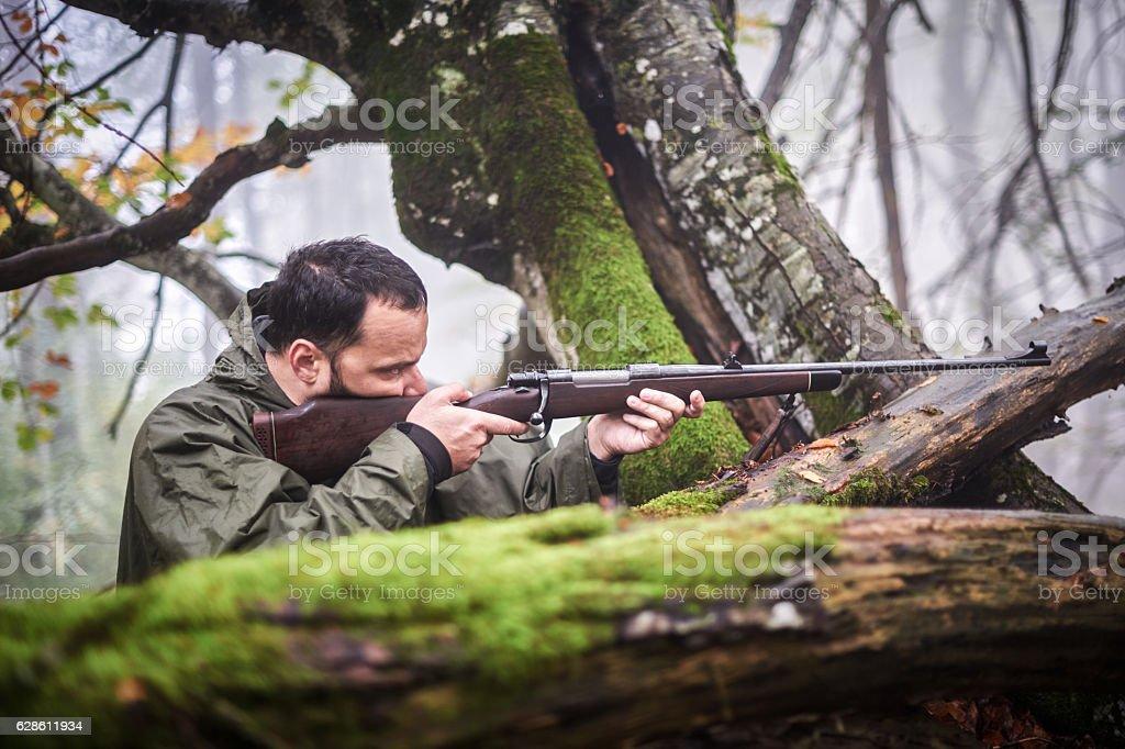 Hunter shooting at target stock photo